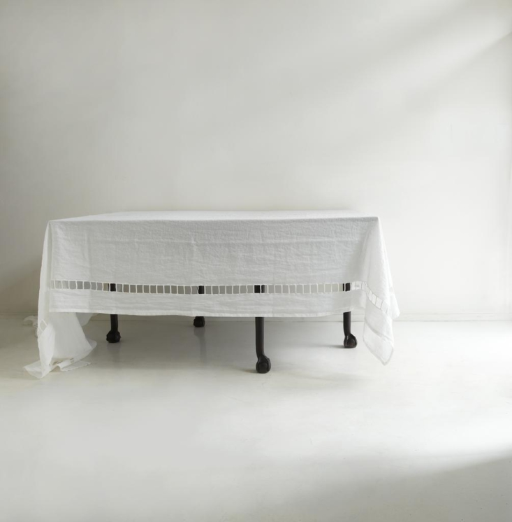 This is a fancy tablecloth; see its far less expensive cousin in High/Low: World's Most Elegant Linen Tablecloth?