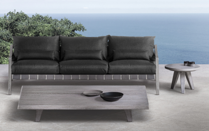 The Del Mar Outdoor Sofa—available in two lengths, 7\2 inches and 90 inches (shown here)—is the ideal place to lounge, the outdoor answer to the favorite relaxation spot indoors. It's paired with the low teak Del Mar Rectangle Cocktail Table and Del Mar Side Table.