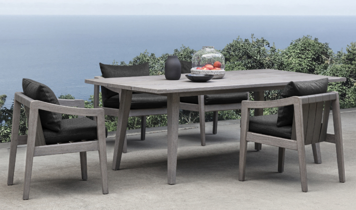 Like the rest of the collection, the Del Mar Rectangle Dining Table is equal parts artisan-crafted and durable for outdoor life, with natural teak designed to withstand exposure to the elements. It's paired with Del Mar Outdoor Dining Chairs with thick cushions.