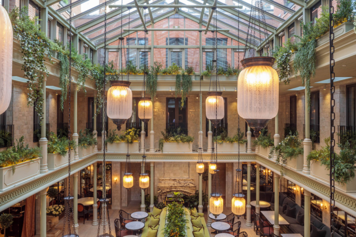 The building's original courtyard was created so that defendants could be driven inside the courthouse away from the crowds outside – now it has been transformed into a glass topped atrium, with pale celadon green pillars and iridescent tiled walls while etched glass lanterns and tiered hanging gardens create an Edwardian hothouse mood. Down in the dining area a vast trough contains miniature orange trees, clipped myrtle and ferns creating a verdant atmosphere but with little scent to disturb the diners.
