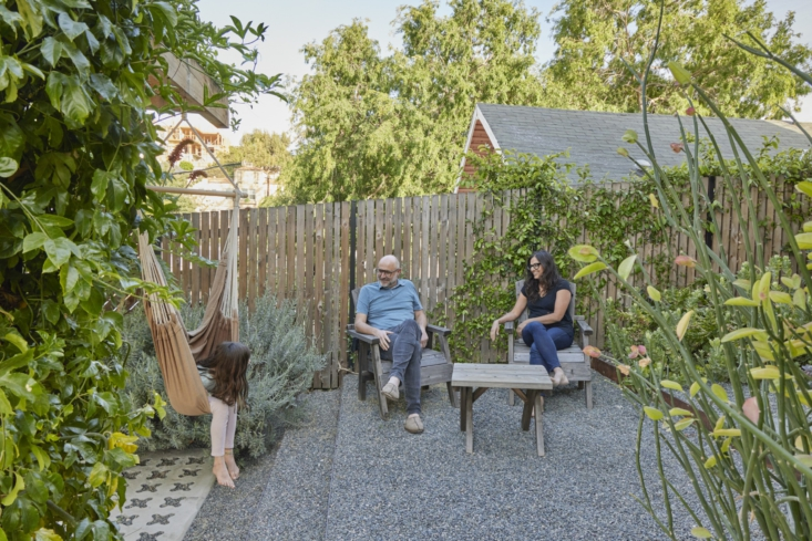 The family at home in their outdoor oasis.