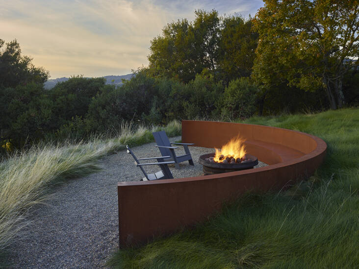 Landscape designers Roche + Roche designed a granite path that snakes it way through the property to this firepit area set off by a Cor-ten steel retaining wall. Photograph by Marion Brennan, from At Home in Wine Country. (N.B.: Note that parts of Northern California are increasingly under wildfire watch, and residential burn bans in certain areas are often imposed throughout the year when the risk is high. Also, be sure to check with your municipality for specific fire pit ordinances before you consider this feature on your property.)