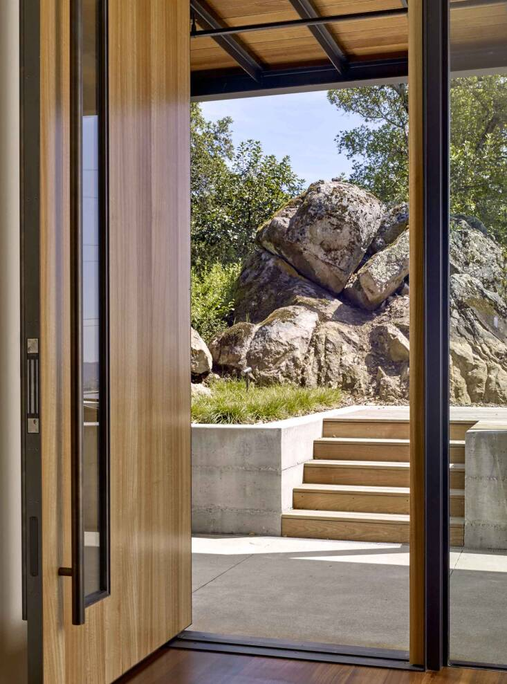 A substantial rock formation posed a challenge for this project, but it ultimately became a defining feature. Photograph by Cesar Rubio, from At Home in Wine Country.