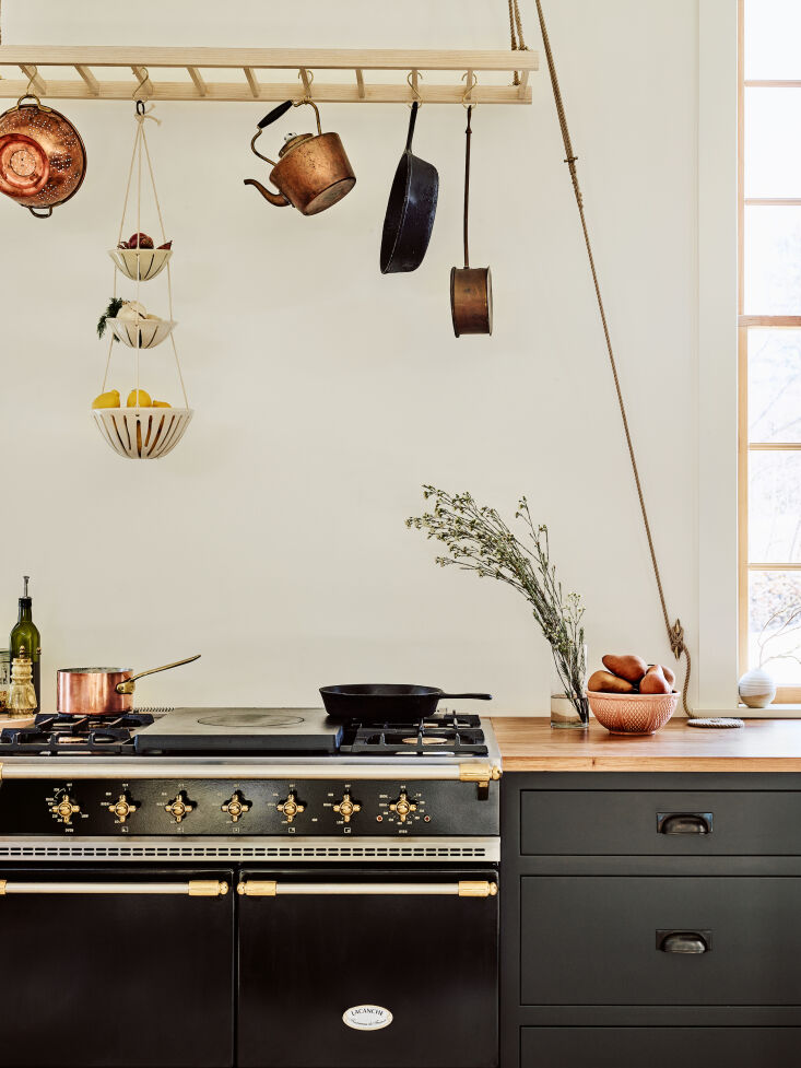 In lieu of a typical pot rack, cabinet maker Ben Block of Block Brothers Kitchen, devised this cool version which seems to be inspired by a hanging laundry rack. Photograph by Jared Kuzia, from Kitchen of the Week: Rethinking Perfection in a Cabinetmaker's Own Kitchen in Maine.