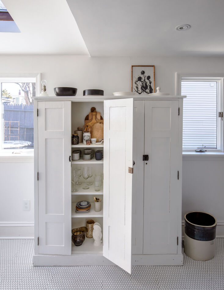 Not enough storage? Seek out a vintage armoire, usually cheaper than a built-in pantry, for the job. Photograph by Justine Hand, from A Game of Clue: A Stylist's Redone Victorian Cottage in New England.