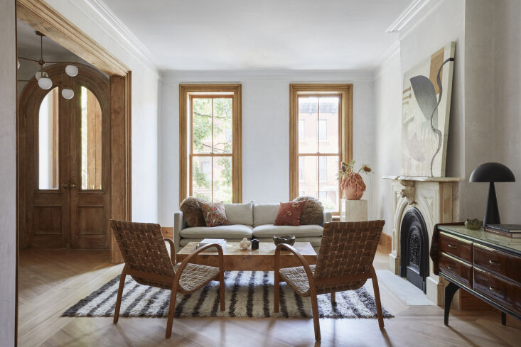 The original wood millwork in this Brooklyn brownstone looks fresh and modern when stripped to its natural tone. Photograph by Jonahtan Hokklo, courtesy of TBo (@TBo_architecture), from An \1890 Brooklyn Townhouse, Reinvented for Modern Times.
