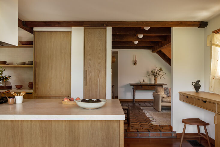 The built-in desk in the kitchen usually feels like an &#8\2\17;80s design gimmick, but this streamlined, modern version (at right) makes a strong case for its revival. Photograph by Laure Joliet, from Before and After: A Summery Bungalow in Topanga, California, Redone by an LA Designer.