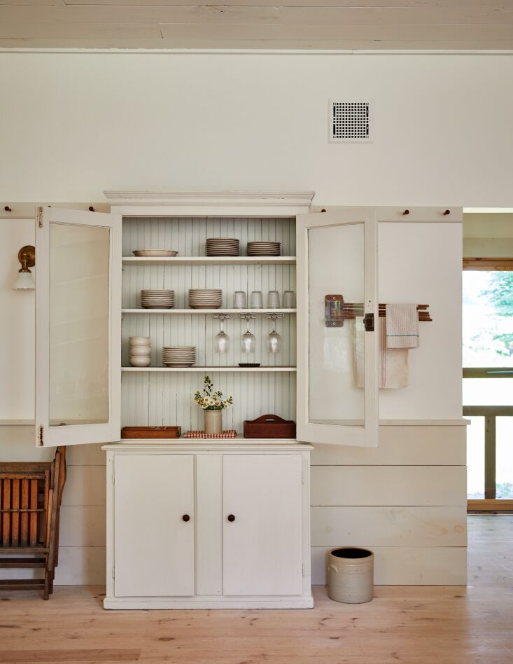 The simple Shaker design of this hutch feels fresh and modern. Photographby Christian Harder, from Simple Good Things: \13 Ideas to Steal from a Shaker-Inspired Farm & Fermentory in the Catskills.