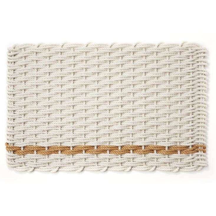 Made in Maine, this Large Rope Doormat (in oyster and honeycomb) is \$\130 at Hudson Grace.