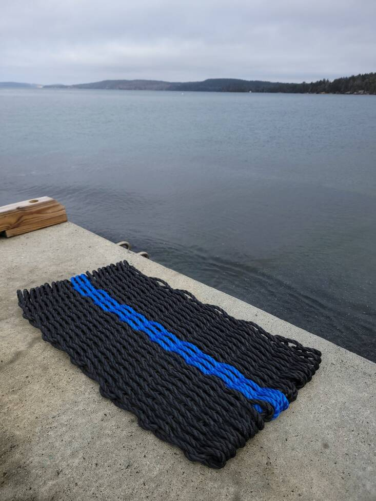 LittleSaltyRopeCo&#8\2\17;s Thin Line Collection includes this black and blue doormat; from \$49.95 on Etsy.