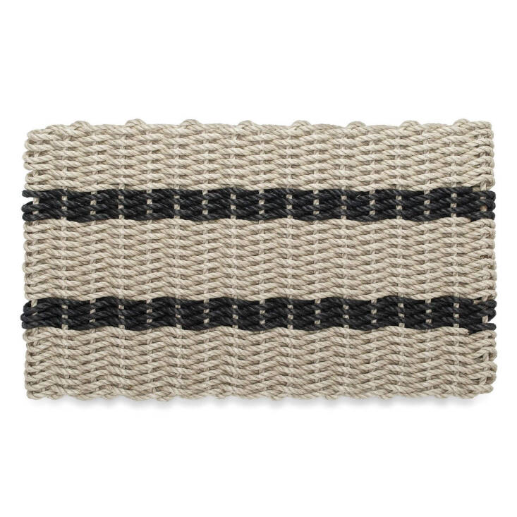 From New England Trading Co.&#8\2\17;s Wicked Good line of handwoven Nautical Rope Doormats, this one features a classic tan and black palette; \$59.95.