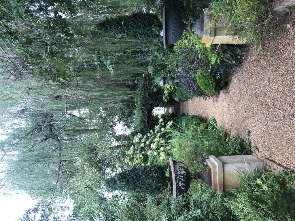 Entrance to walk that extends through the garden