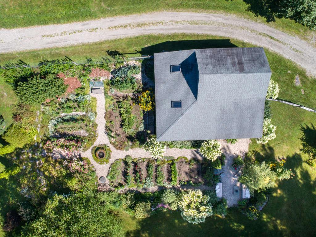 Drone view of Cruciform vegetable garden by Ren quote below by Robert H Harrison