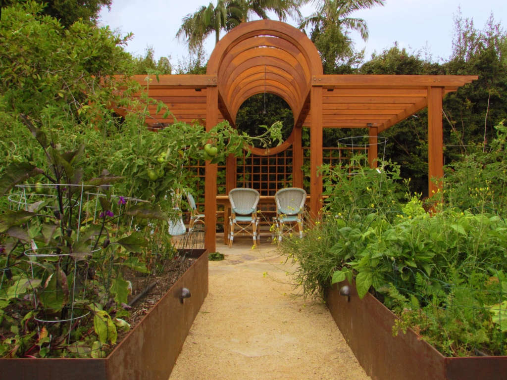 The Raised Beds Frame the Entrance to the Pergola