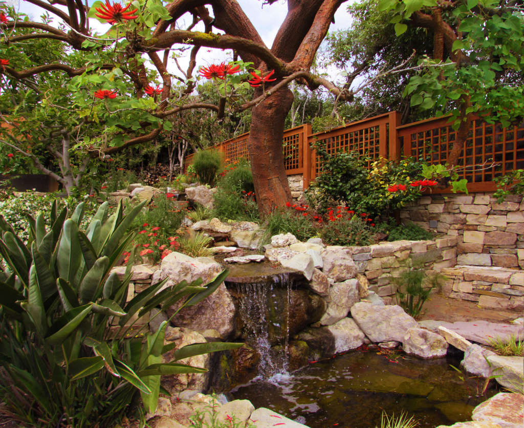 The Waterfall Culminates on the Bottom Level of The Garden in a Koi Pond