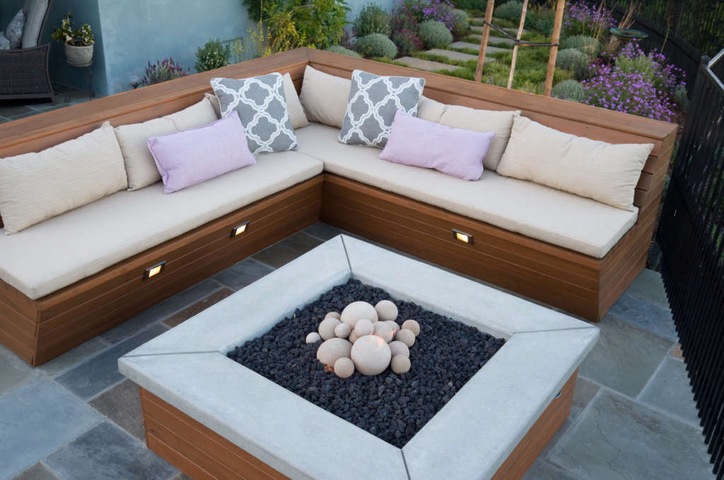 A Custom Built Bench and Fire Pit Provide a Comfortable Spot to Watch the Sunset