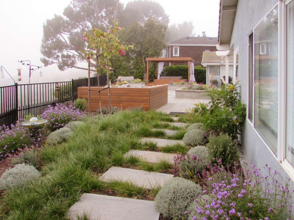 A Pretty Garden Welcomes You Onto the Patio