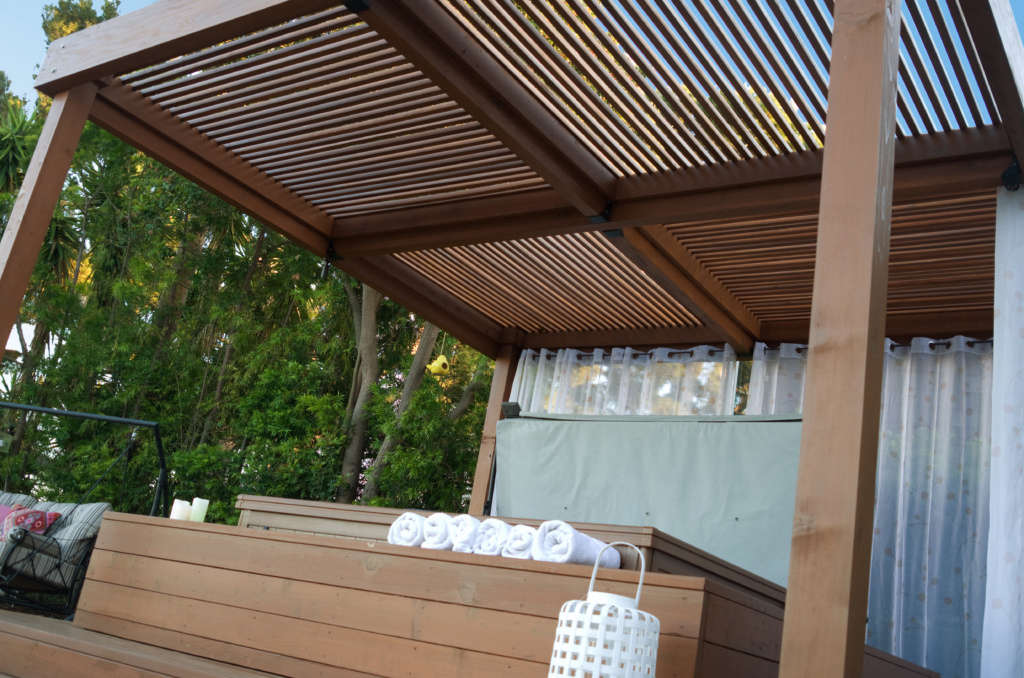 A Custom Pergola and Jacuzzi Give You Everything You Need to Kick Off Your Shoes