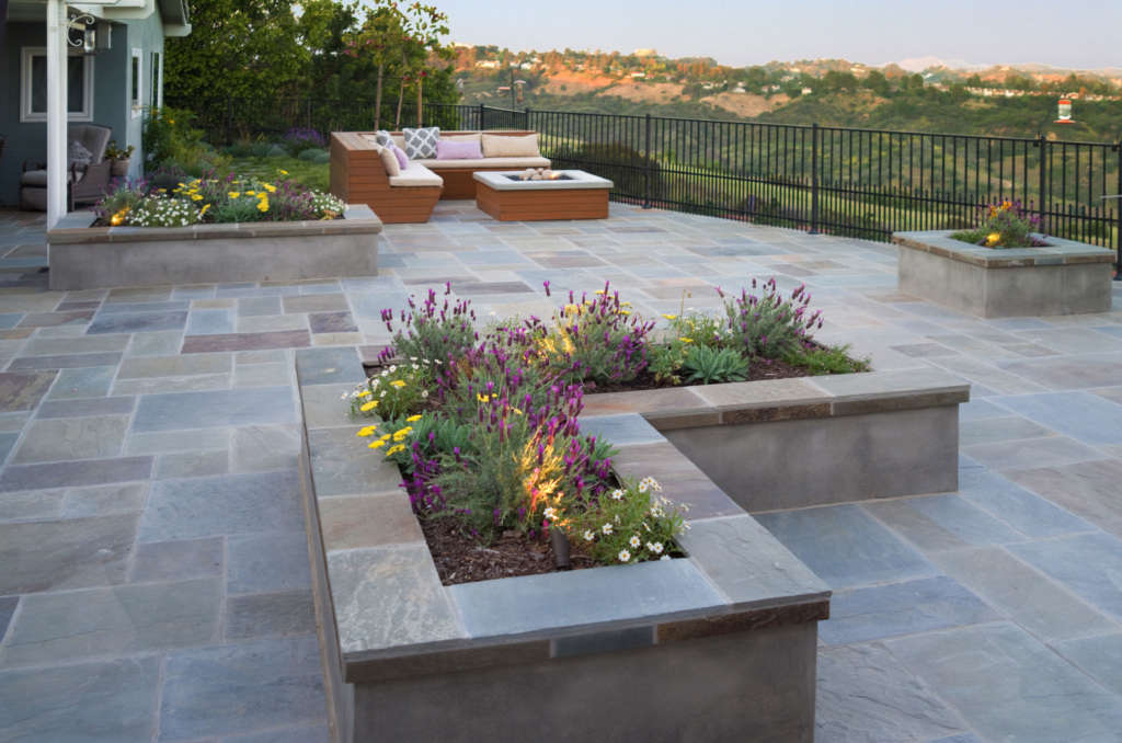 Planters Break Up the Expansive Deck and Provide Extra Seating