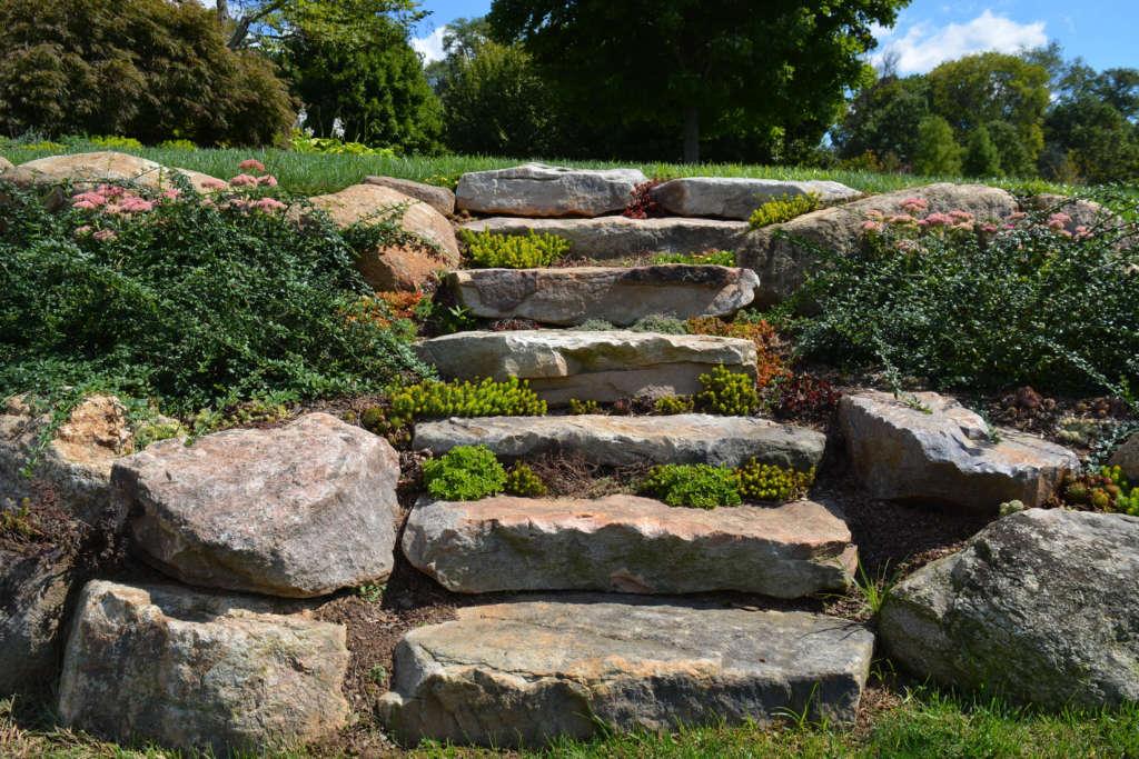 Installation of random boulder slab steps make this home very charming.