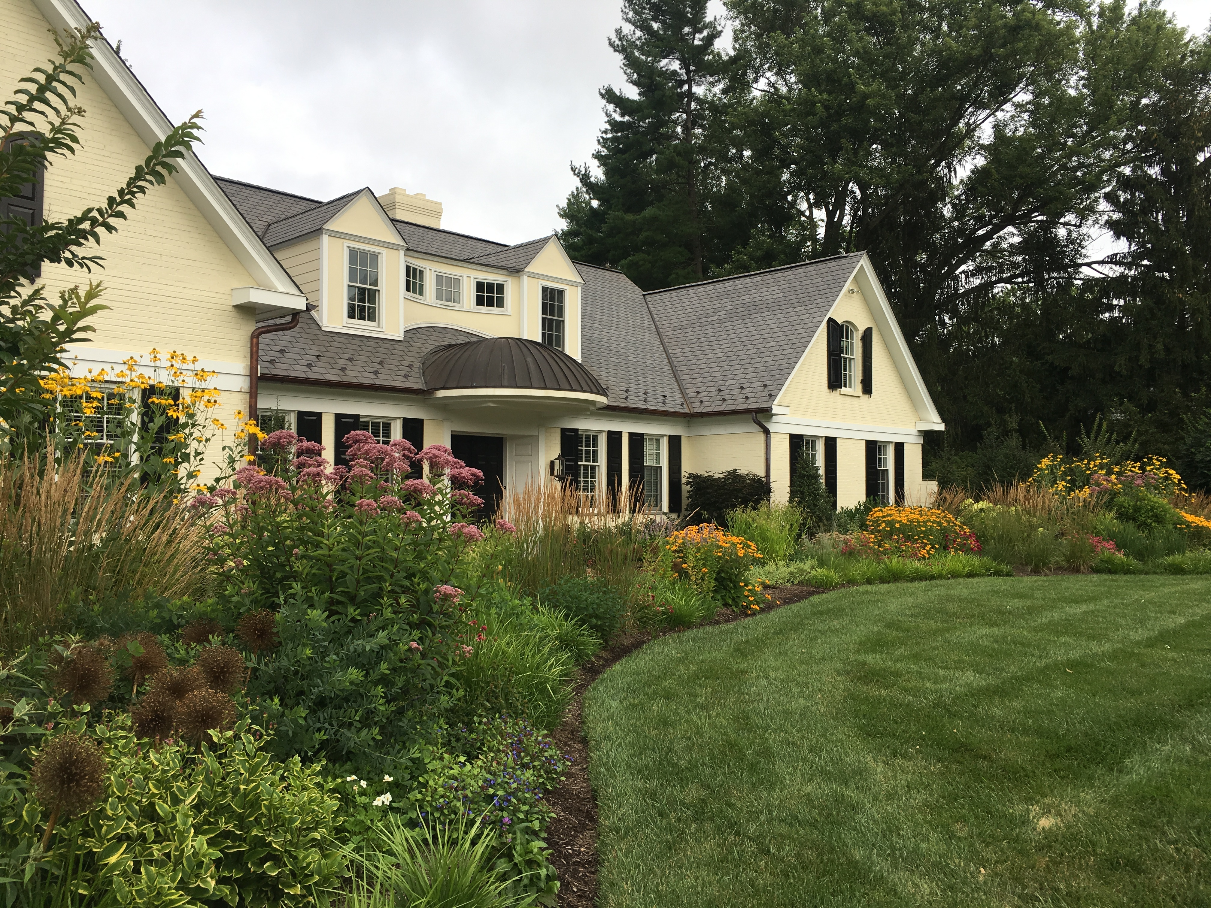 This formal home was professionally landscaped.  It will take your breath away!