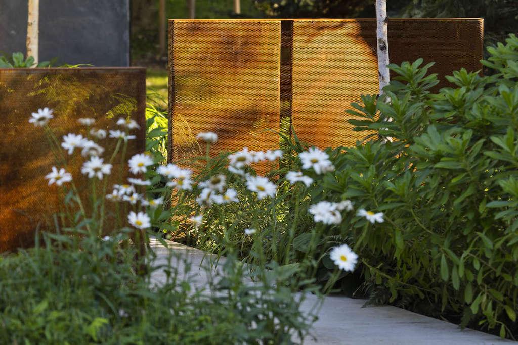 Perforated weathering steel screens