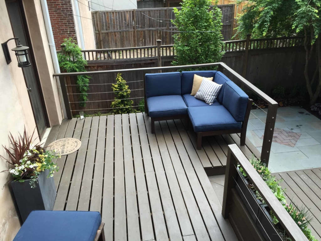 Built-in seating in the garden is key in small outdoor living spaces.