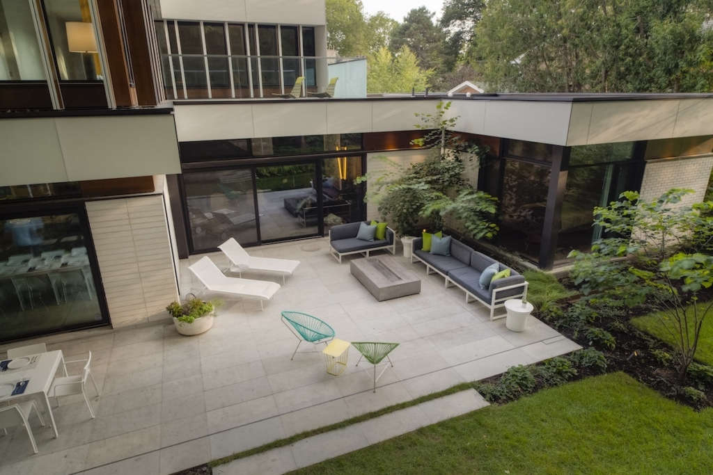 Framing functional spaces with lush plantings.