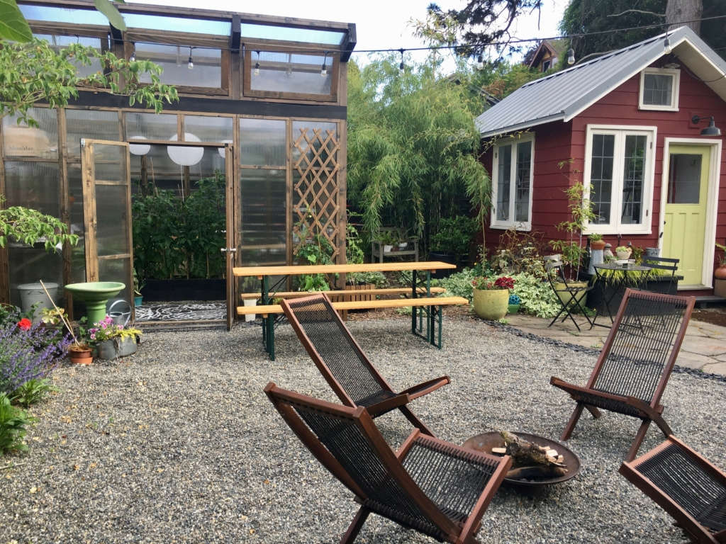 Greenhouse, she-shed and firepit.
