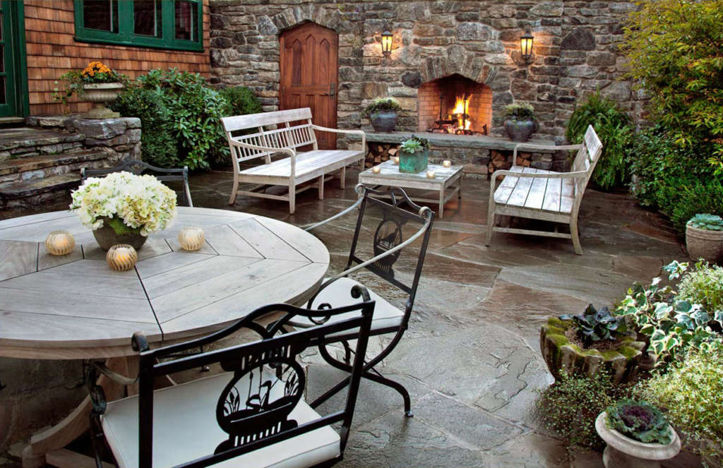 A Stone Fireplace Warms the Main Terrace