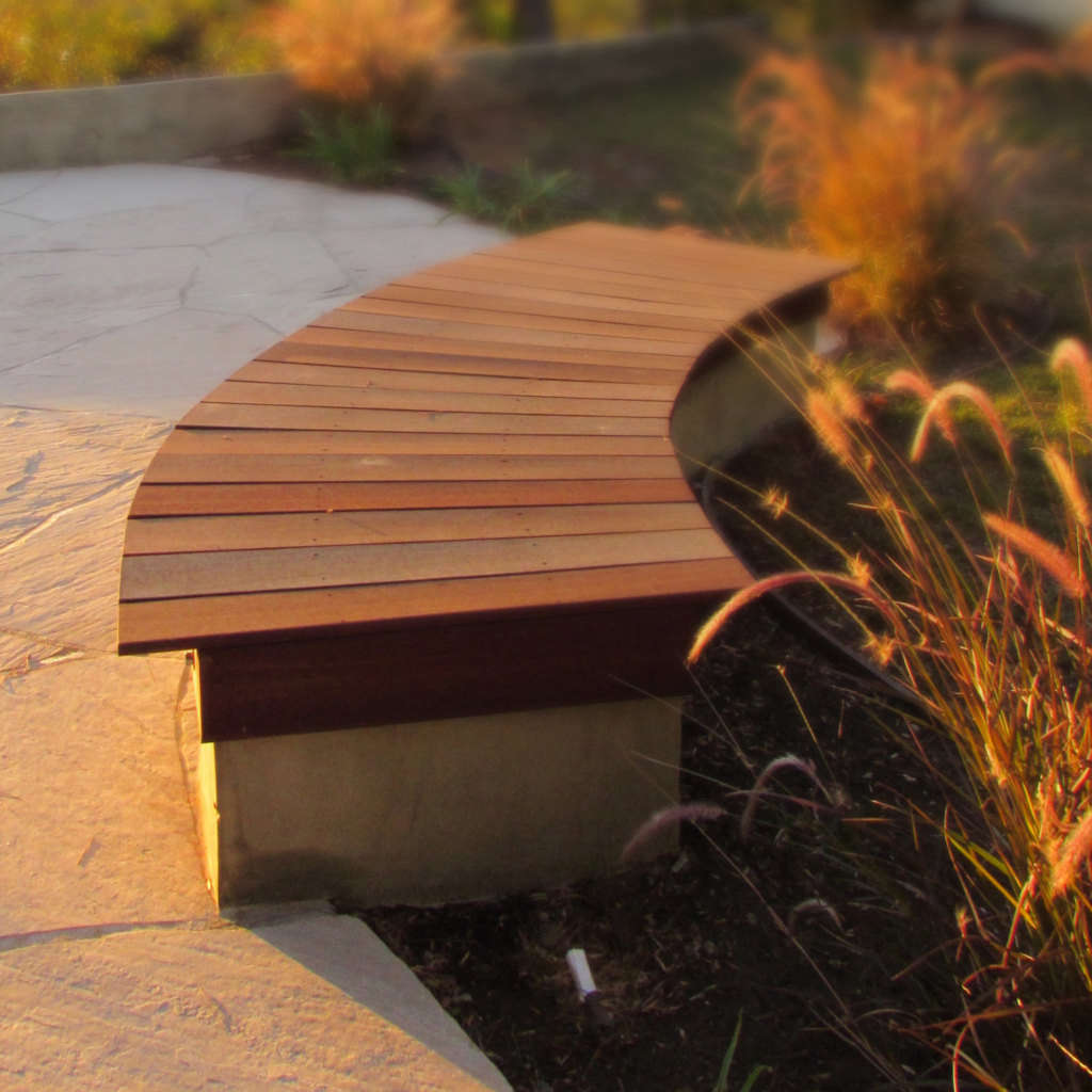 A Custom Wood and Concrete Bench is Placed Next to the Lawn