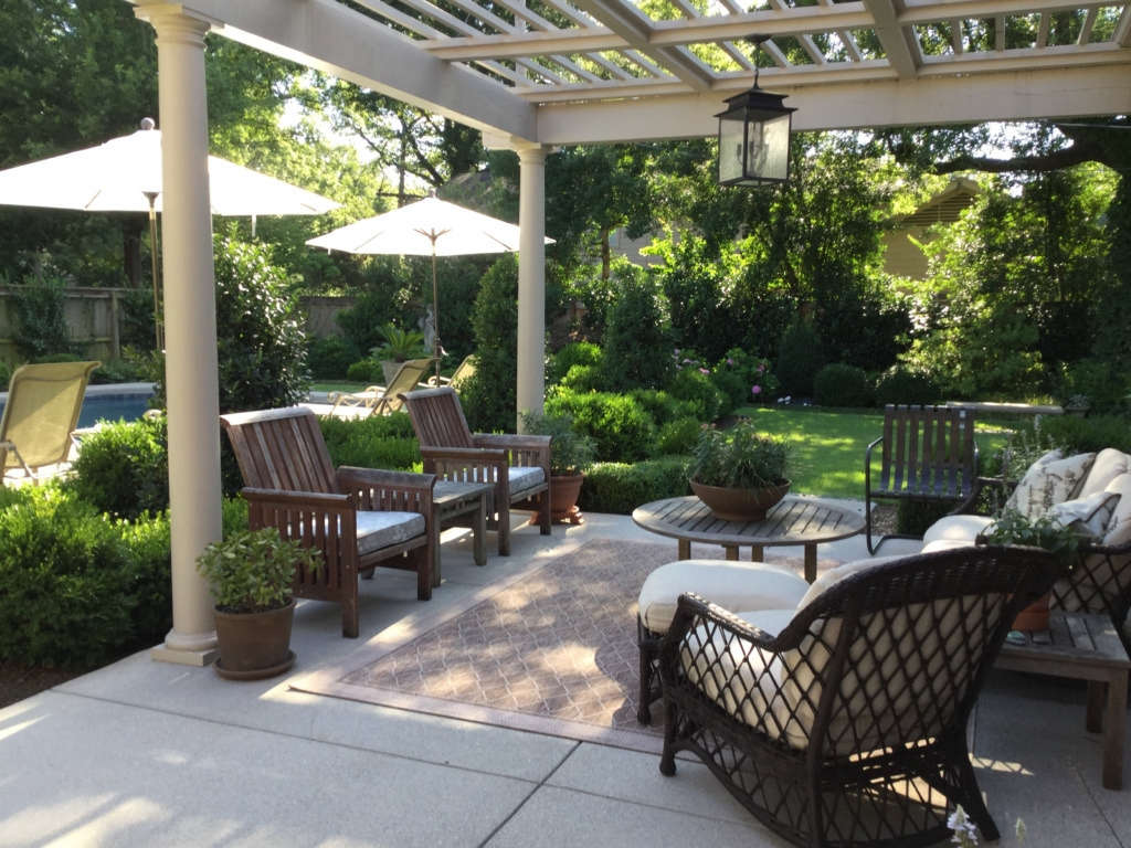 Pergola covered patio provides dappled sunlight in the afternoon.