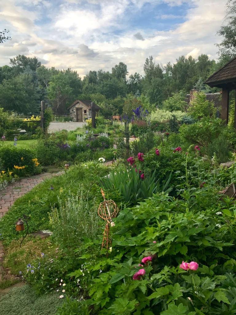 Big Sky Dwarfing a Peek-a-Boo, Stone Garden Shed