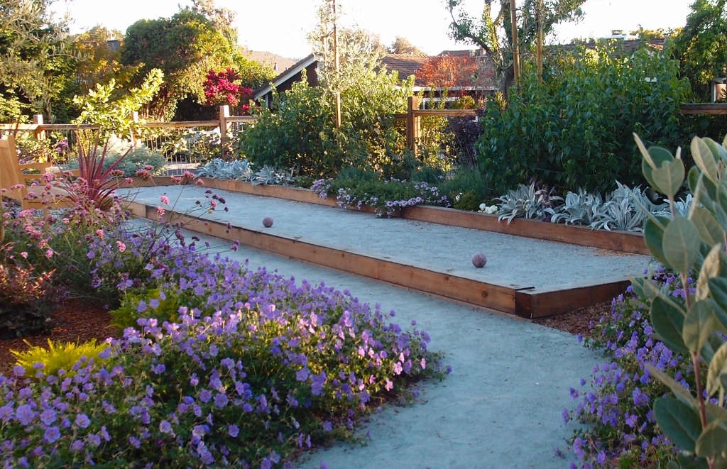 Bocce court surrounded by edibles and ornamental