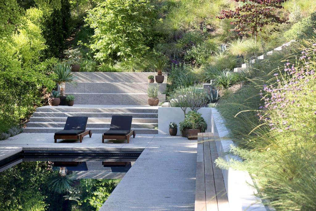 Meadow, steps, bleachers + pool.