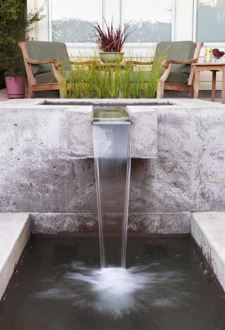Arterra Landscape Architects specified a waterproof additive for the concrete mix for the fountain, allowing it be unlined. For more, see Gardenista Considered Design Awards . Photograph byMichele Lee Willson.