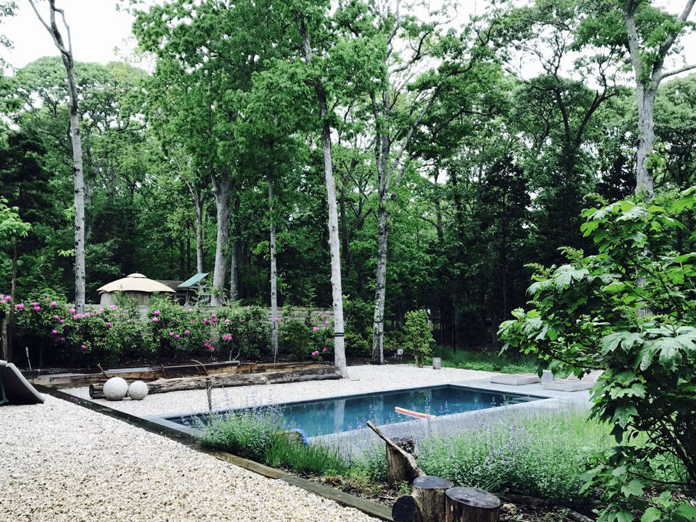 Gravel Wraps the Pool and House
