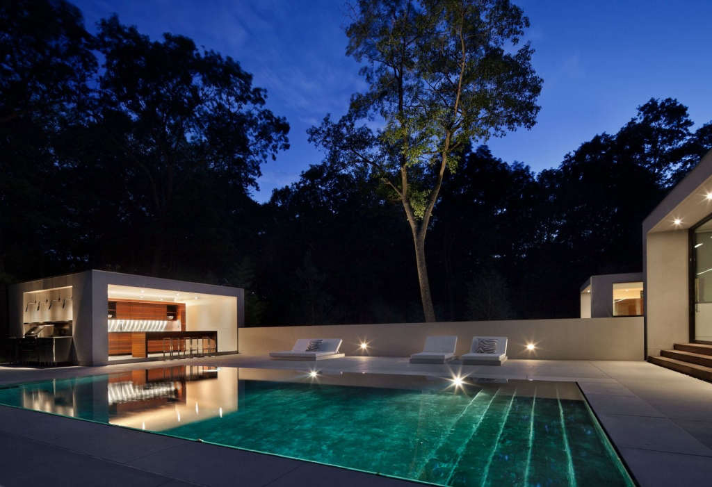 Pool and Pool House Juxtaposed at Night