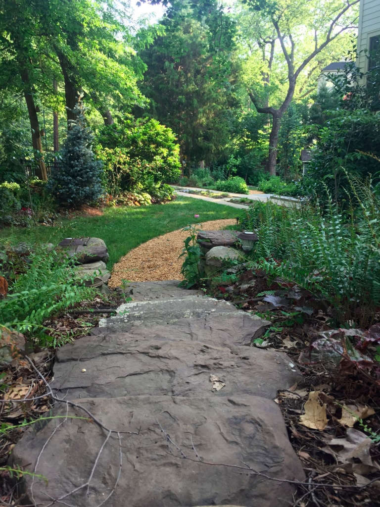 The long view: sideyard passage from the entry garden to the rear cutting garden